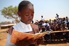 Girl reads out loud during International Literacy Day celebrations in Zambia